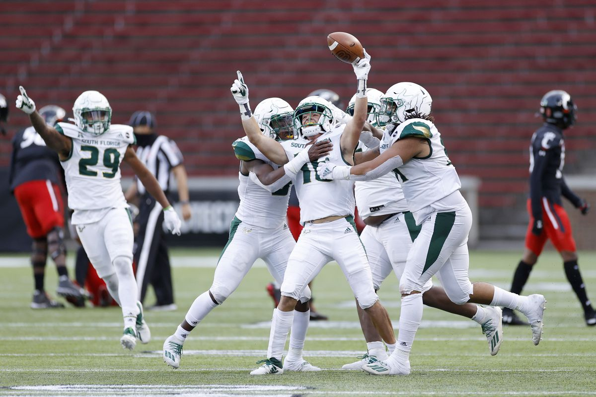 Brock Nichols of the South Florida Bulls celebrates with a group of teammates following an interception during a game against the Cincinnati Bearcats at Nippert Stadium on October 3, 2020 in Cincinnati, Ohio.