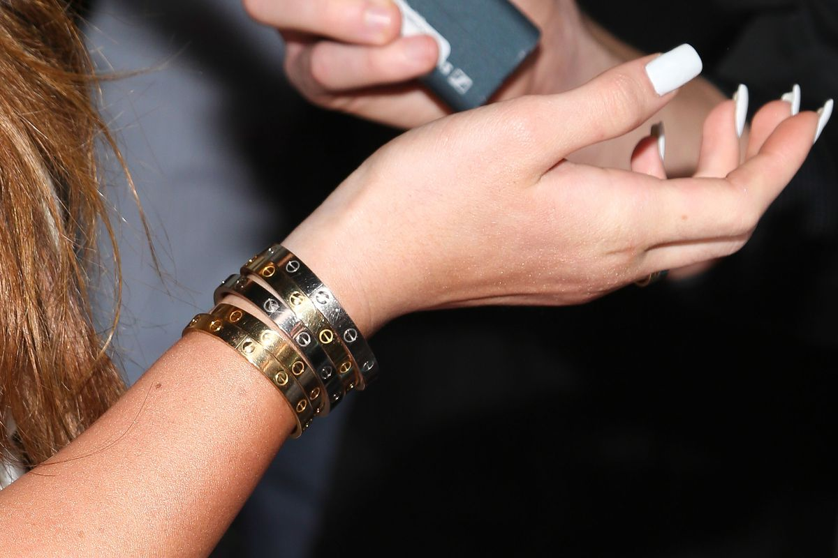 6b8c1f662 Kylie Jenner wears five Cartier bracelets to a party in Hollywood,  California, on November 13, 2013. Imeh Akpanudosen/Getty Images