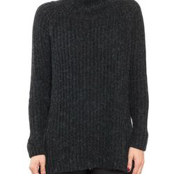 """Anine Bing turtleneck sweater in charcoal, <a href=""""http://www.aninebing.com/collections/knit/products/turtleneck-sweater-in-charcoal """"target=""""_blank"""">$299</a>"""
