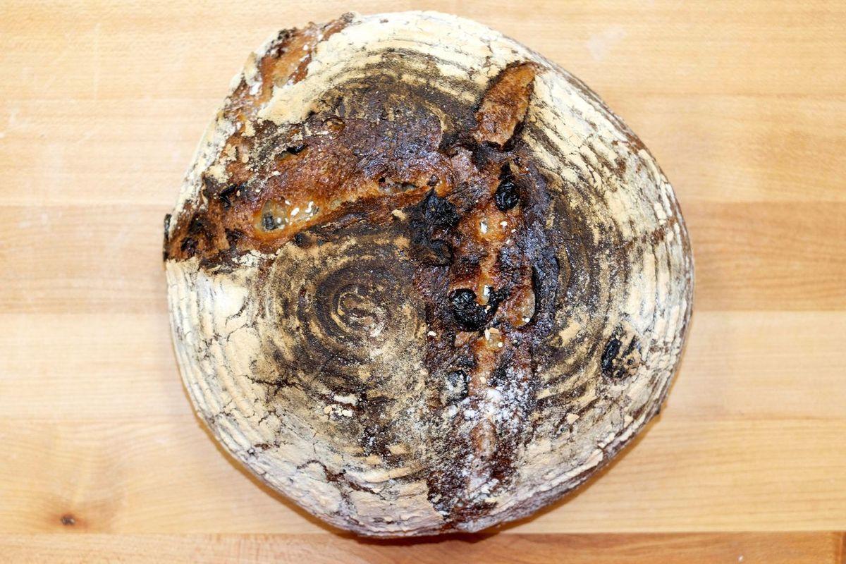 A sourdough boule on a wood surface