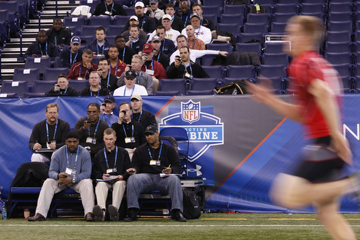 NFL scouts watch players at the Scouting Combine
