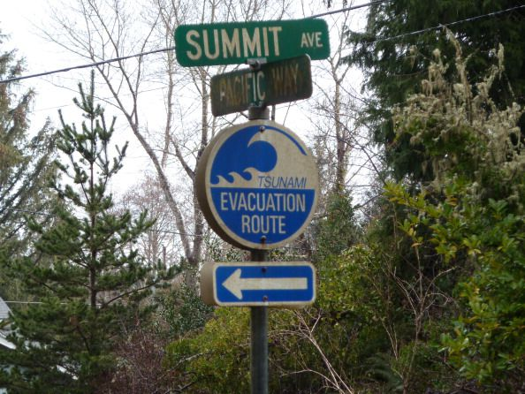 A sign in the coastal town of Seaside, Oregon, seen on March 19, 2011, shows residents the directions for higher ground in case of a tsunami. (Shaun Tandon/AFP/Getty Images)