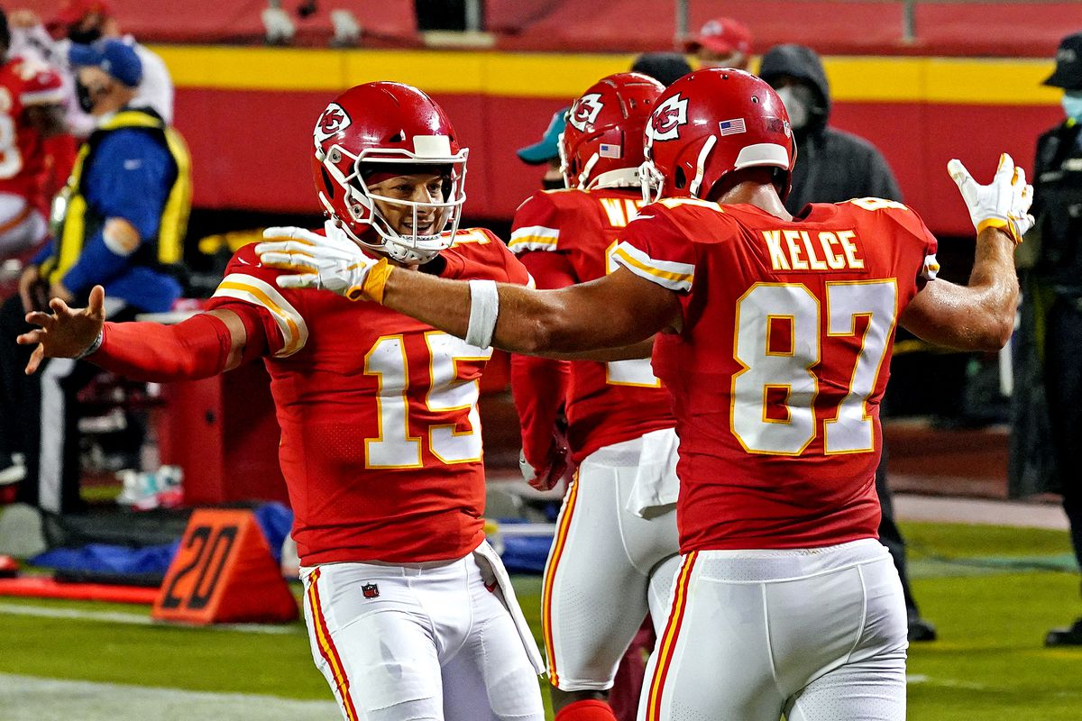 Kansas City Chiefs quarterback Patrick Mahomes and tight end Travis Kelce celebrate after a touchdown during the first half against the Houston Texans at Arrowhead Stadium.