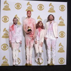 """Members of Imagine Dragons, from left, Ben McKee, Ben Reynolds, Wayne Sermon and Dan Platzman pose in the press room with the award for best rock performance for """"Radioactive"""" at the 56th annual Grammy Awards at Staples Center on Sunday, Jan. 26, 2014, in Los Angeles."""
