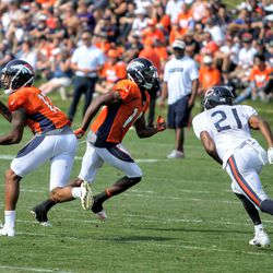Broncos rookie WR Bryce Bobo (13) looks to receive a pass as fellow WR Emmanuel Sanders (10) runs past, with Bears rookie DB Michael Joseph (21) defending.