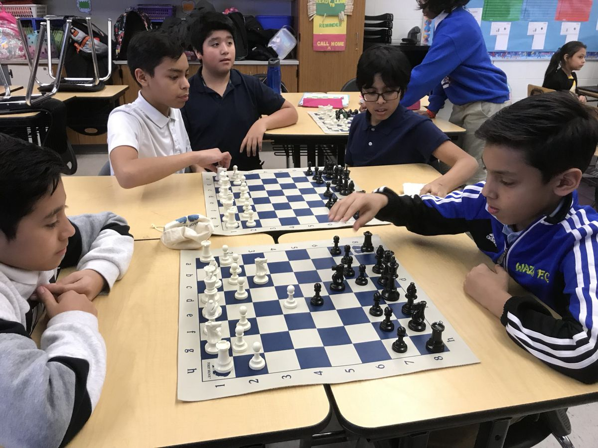 Munger Elementary-Middle School chess students practice after class Tuesday.