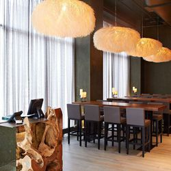 """""""sea urchin lights"""" hang over the lounge area just off the host stand"""