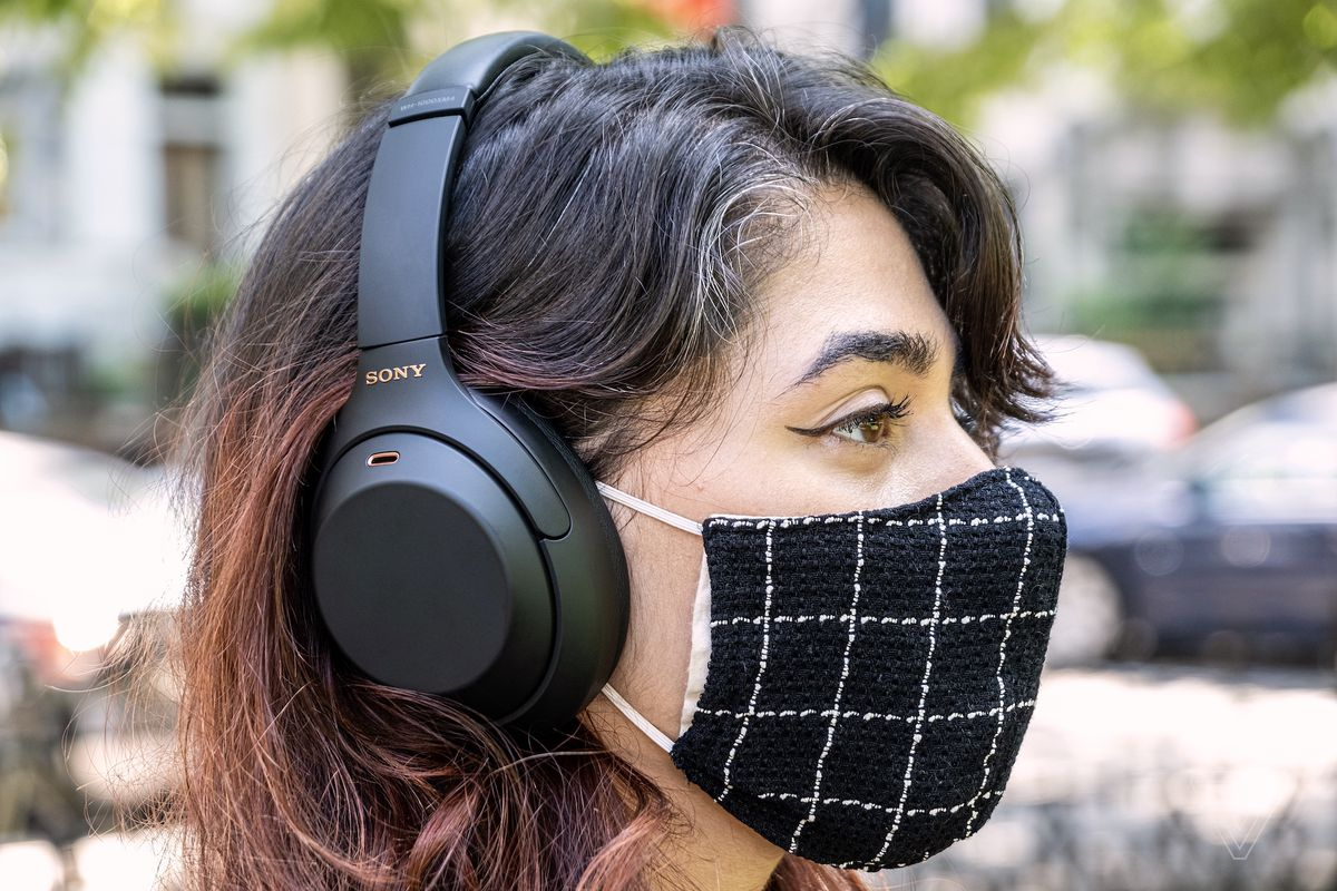 A photo of Sony's 1000XM4 noise-canceling headphones on someone's head.