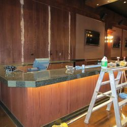 This will be the Lucky Bar. Behind it, a mural of the old O'Shea's will go up.