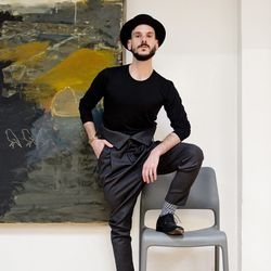 <b>Eric Antos</b>, Customer Service Representative, wearing a vintage black bowler hat, black Uniqlo longsleeve crewneck tee, charcoal Rochambeau high-waist pants (from TRR), black Heschung oxfords (from TRR), and a gold and silver Anndra Neen cuff (from