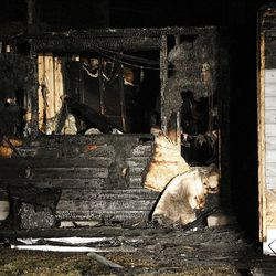 Charred walls show at the home of Josh Powell in Puyallup, Washington, Sunday, Feb. 5, 2012.