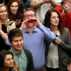 The crowd reacts as former Gov. of Mass. Mitt Romney leaves the Hinckley Institute of Politics after speaking about the 2016 presidential race at the University of Utah in Salt Lake City on Thursday, March 3, 2016.