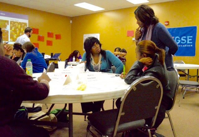 Michelle Armstrong (standing), dean of Relay Tennessee, checks in with her students at a weekly class.