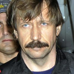 FILE - In this Tuesday Nov. 16, 2010 file photo provided by the Drug Enforcement Administration Russian arms trafficker Viktor Bout is shown in U.S. custody after being flown from Bangkok to New York in a chartered U.S. plane. The ex-Soviet officer turned arms dealer faces a mandatory minimum of 25 years in prison at sentencing Thursday, April 5, 2012.