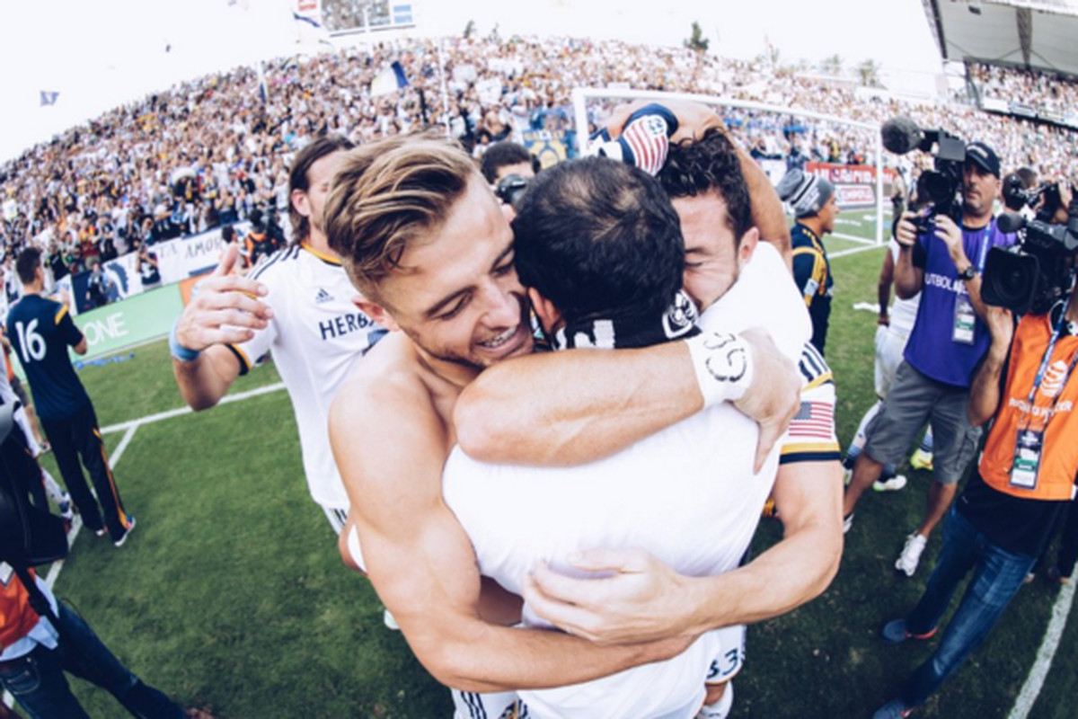 Robbie Rogers and Landon Donovan celebrate their 2014 MLS Cup victory.