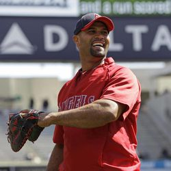 Los Angeles Angels first baseman Albert Pujols warms up before the Angels baseball game against the New York Yankees at Yankee Stadium in New York, Friday, April 13, 2012.