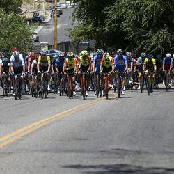 The peloton rides through a neighborhood during Stage 3 of the Tour of Utah near Layton on Thursday, Aug. 15, 2019.