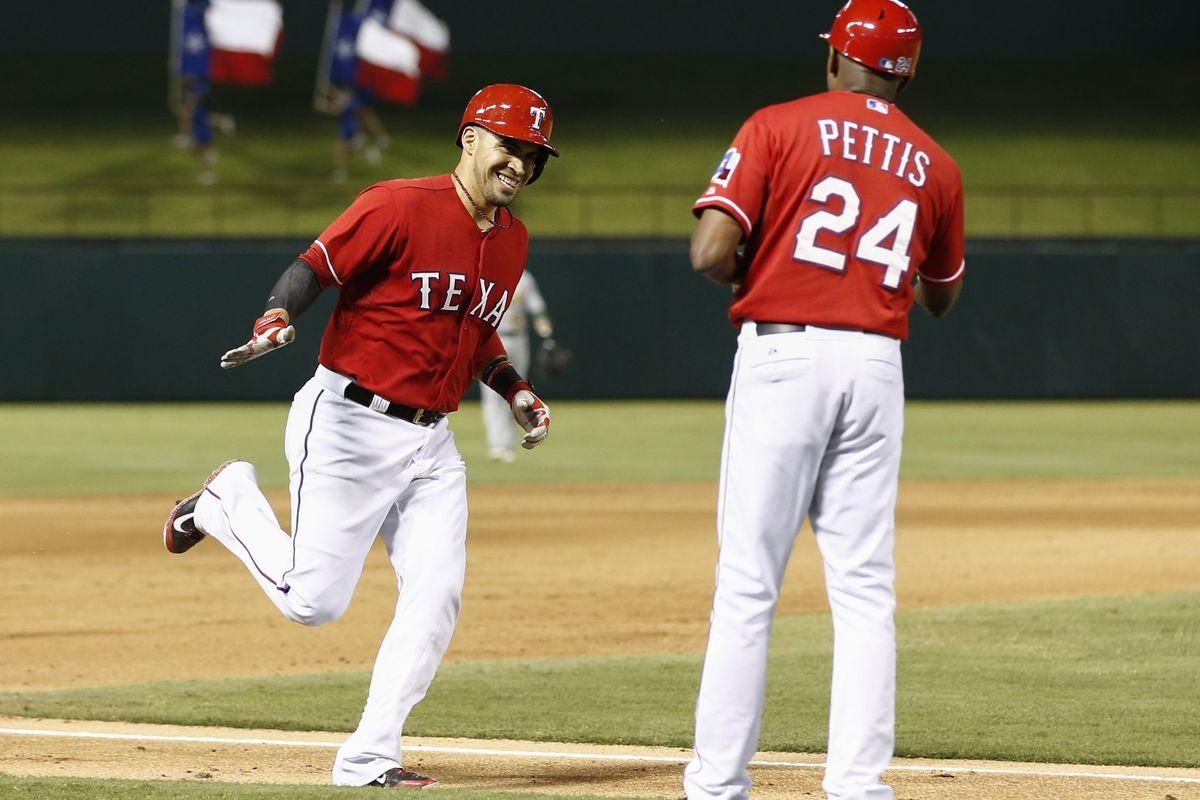 Robinson Chirinos celebrates a two-run home run in the seventh inning.
