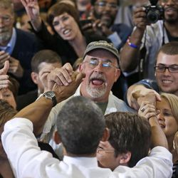 President Barack Obama greets supporters after speaking at a campaign event at Bowling Green State University, Wednesday, Sept. 26, 2012, in Bowling Green, Ohio.