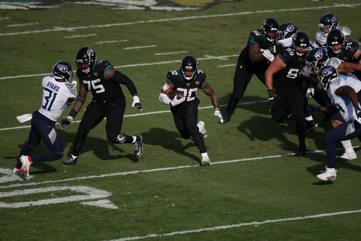 Jacksonville Jaguars Running Back James Robinson (30) runs with the ball during the game between the Tennessee Titans and the Jacksonville Jaguars on December 13, 2020 at TIAA Bank Field in Jacksonville, Fl.