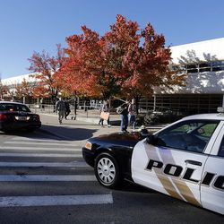 Police cars are stationed outside Mountain View High School in Orem on Tuesday, Nov. 15, 2016, following a stabbing at the school.
