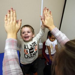 Kale, front, and Edynn participate in therapy work sessions during the Autism Bridges program at Kids on the Move in Orem, Tuesday, Oct. 15, 2013.