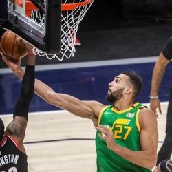 Utah Jazz center Rudy Gobert (27) shoots the ball during the game at Vivint Smart Home Arena in Salt Lake City on Thursday, April 8, 2021.