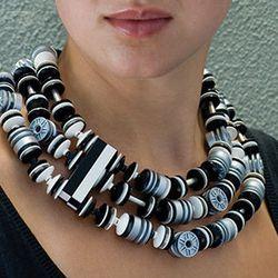 Silver hubs trio necklace, $375