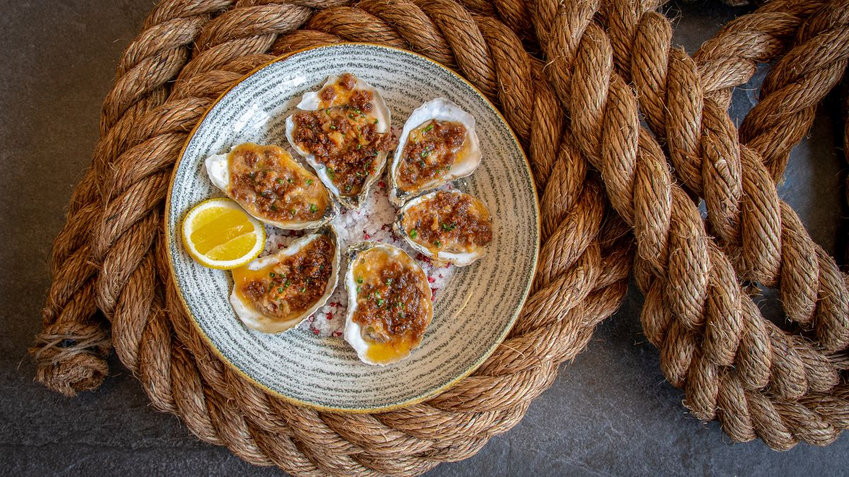 Roasted oysters at the Point are topped with breadcrumbs and a compound butter made with miso, crab meat, and reduced crab stock