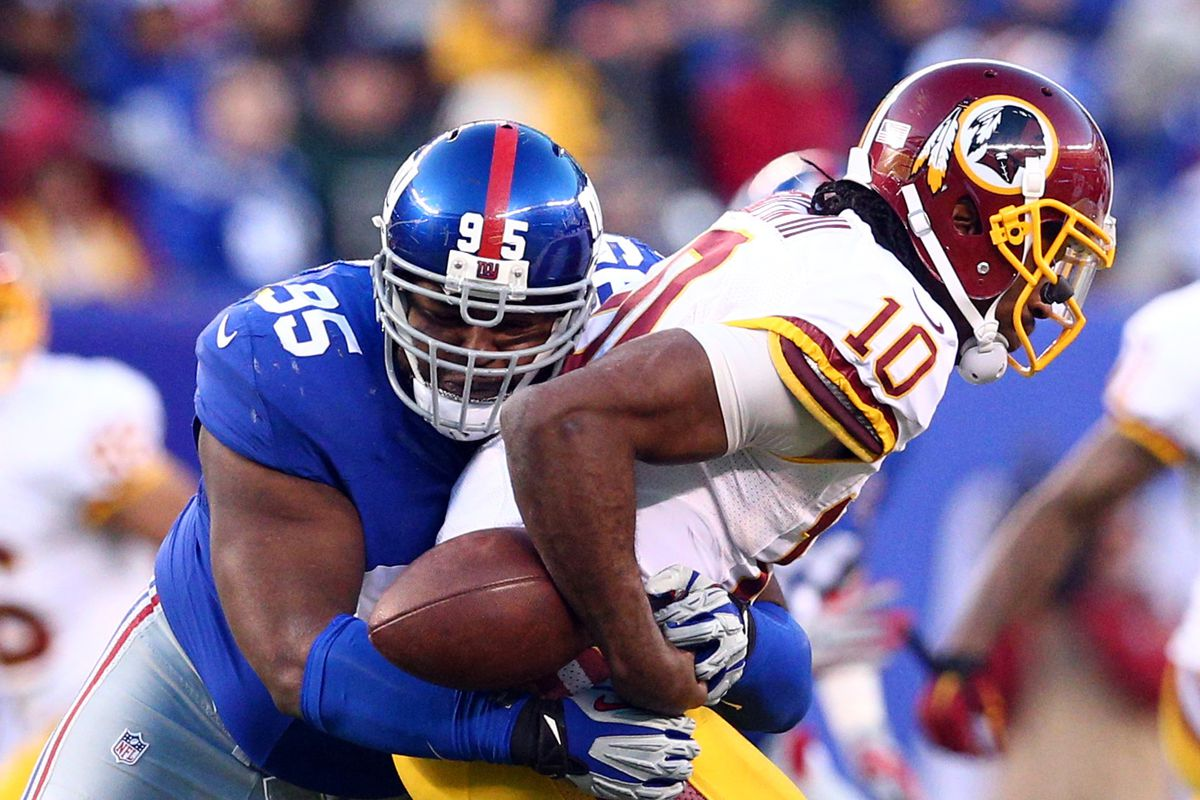 Johnathan Hankins forces a Robert Griffin III fumble.