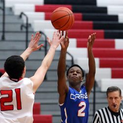 Crane's Rashad Harris (2) scores over Maine South's Essam Hamwi (21) in their 60-40 loss in Park Ridge, Saturday, February 9 2019.   Kevin Tanaka/For the Sun Times