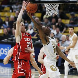 Colorado guard Eli Parquet, right, drives to the basket past Utah forward Mikael Jantunen in the second half of an NCAA college basketball game Sunday, Jan. 12, 2020, in Boulder, Colo.