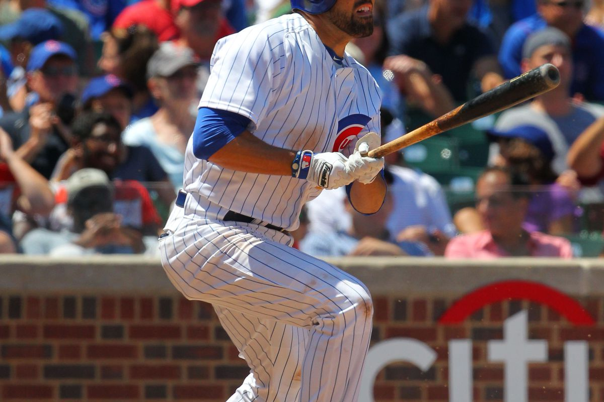 Chicago, IL, USA; Chicago Cubs right fielder David DeJesus hits a single against the St. Louis Cardinals at Wrigley Field. Credit: Dennis Wierzbicki-US PRESSWIRE