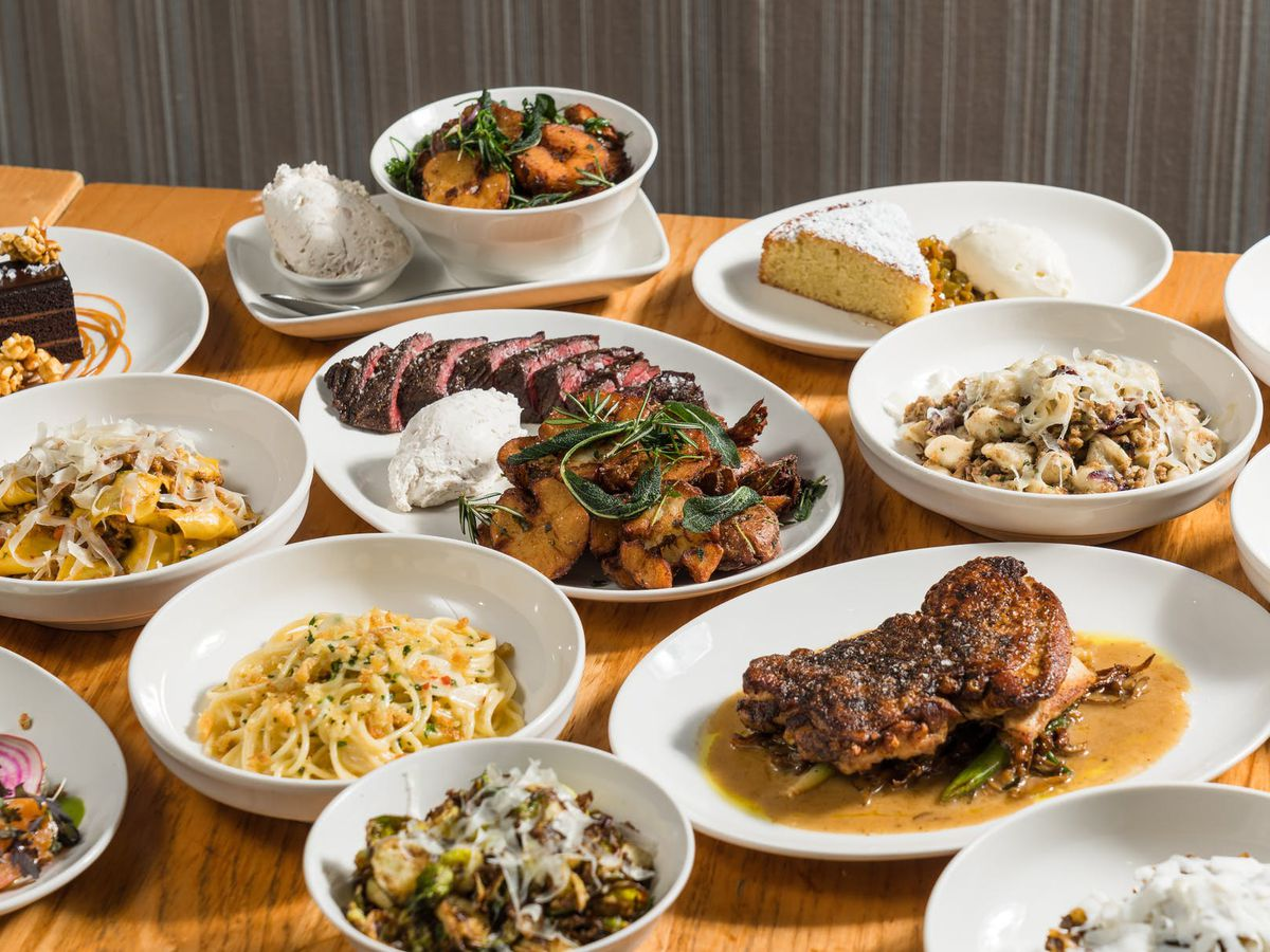 A hefty sampling of various Italian dishes, all on white plates.