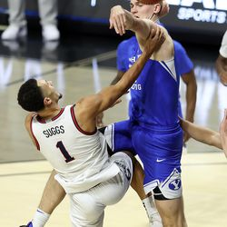 Brigham Young Cougars forward Matt Haarms (3) blocks Gonzaga Bulldogs guard Jalen Suggs (1) as BYU and Gonzaga play in the finals of the West Coast Conference tournament at the Orleans Arena in Las Vegas on Tuesday, March 9, 2021. Gonzaga won 88-78.