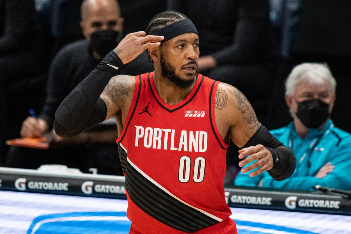 Carmelo Anthony #00 of the Portland Trail Blazers reacts after making a three-point shot against the Charlotte Hornets in the first quarter during their game at Spectrum Center on April 18, 2021 in Charlotte, North Carolina.