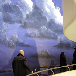 Attendees walk through the visitors center during the 182nd Annual General Conference for The Church of Jesus Christ of Latter-day Saints in Salt Lake City  Sunday, April 1, 2012.