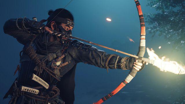 samurai Jin Sakai pulls back a flaming arrow in a screenshot from Ghost of Tsushima