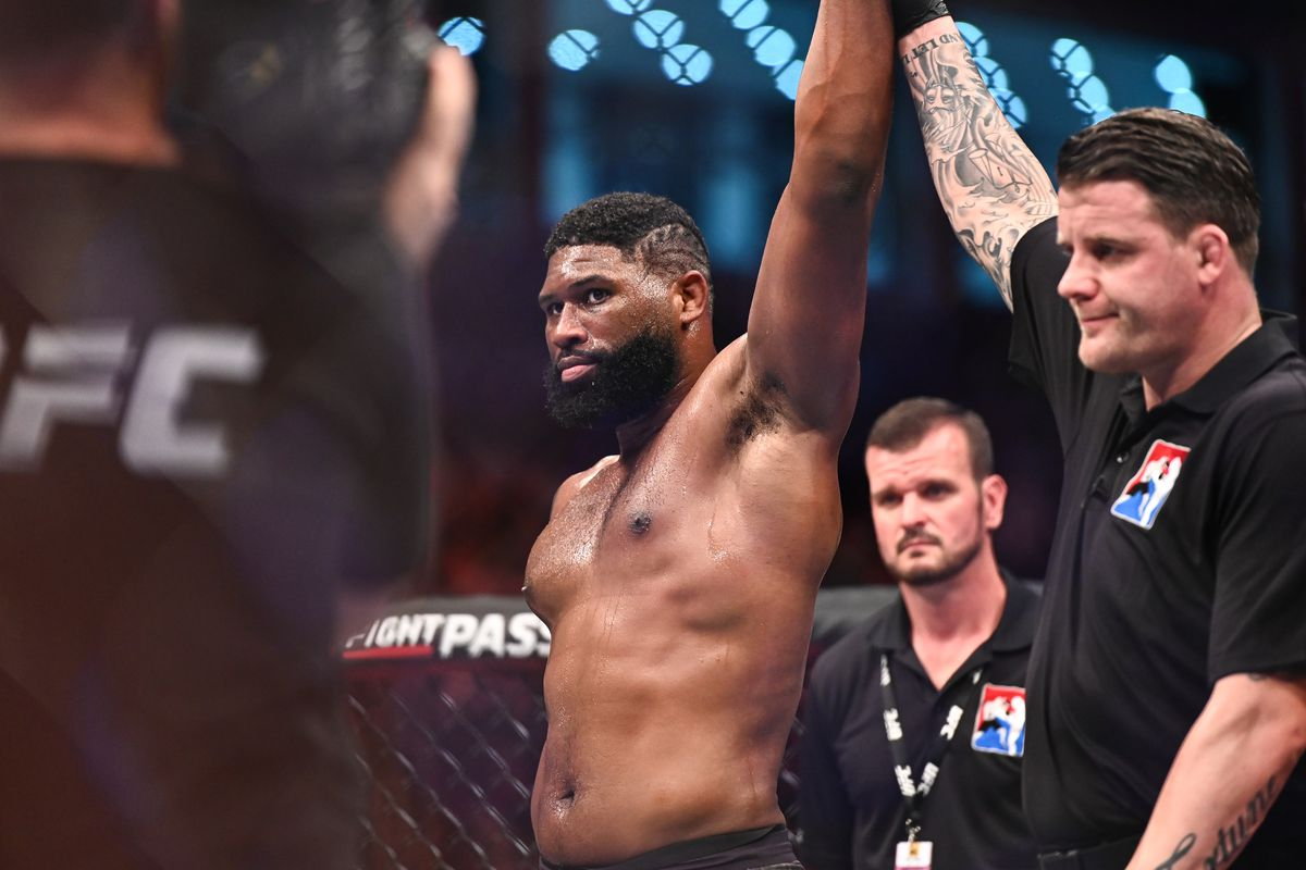 Curtis Blaydes (red gloves) defeats Shamil Abdurakhimov (not pictured) during UFC 242 at The Arena.