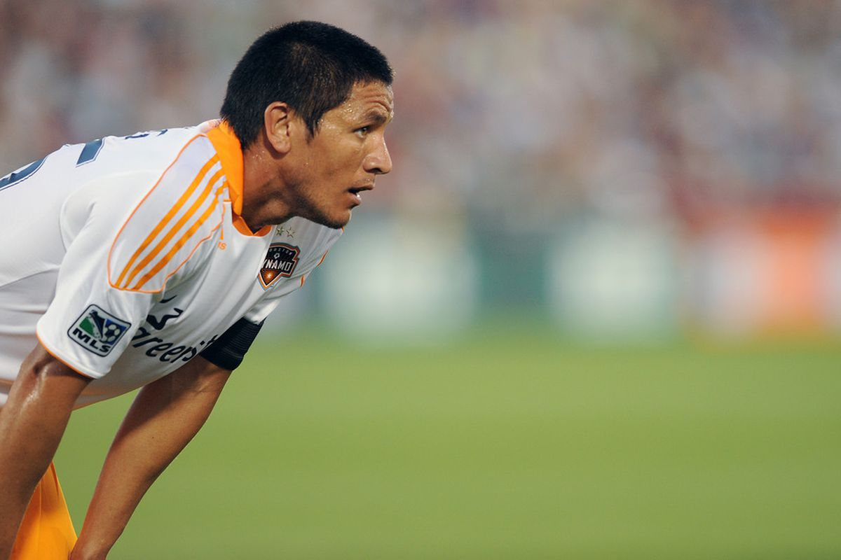COMMERCE CITY, CO - JULY 3:  Brian Ching #25 of the Houston Dynamo reacts to a play against the Colorado Rapids at Dick's Sporting Goods Park on July 3, 2011 in Commerce City, Colorado.  (Photo by Bart Young/Getty Images)
