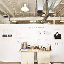 The space has its own coffee bar stationed against the informative Apolis: Uganda Project wall.