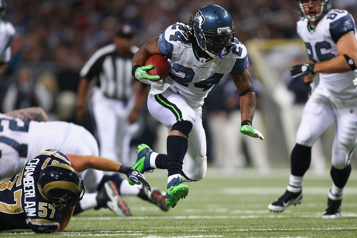 ST. LOUIS, MO - NOVEMBER 20: Marshawn Lynch #24 of the Seattle Seahawks rushes against the St. Louis Rams at the Edward Jones Dome on November 20, 2011 in St. Louis, Missouri.  (Photo by Dilip Vishwanat/Getty Images)