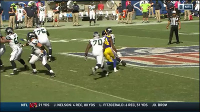 Russell Wilson got sacked so hard by Robert Quinn it turned into a soft landing
