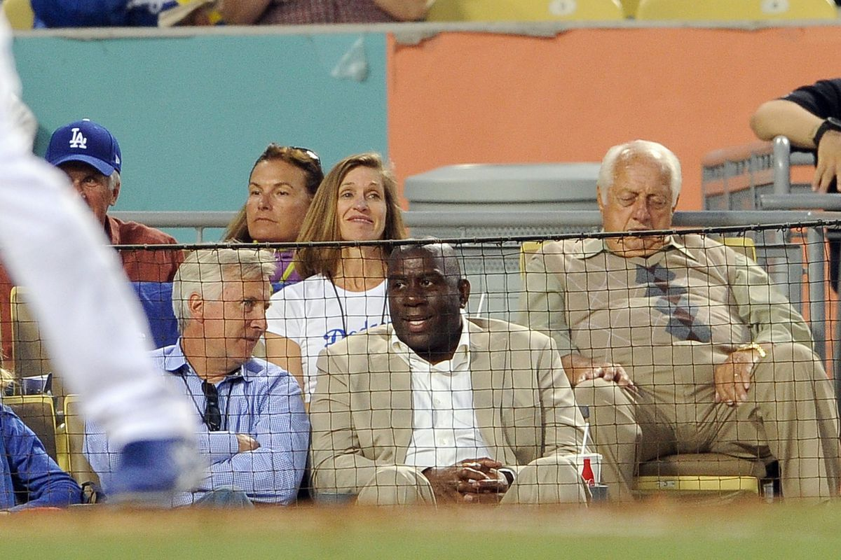 Magic Johnson is back at Dodger Stadium, giving the Los Angeles Times something to write about.