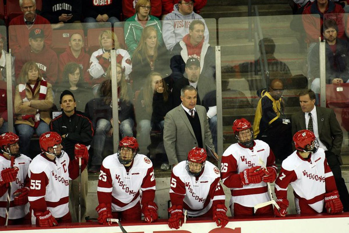 Wisconsin assistant coach Bill Butters (center, gray jacket) coaches his final game from the Badger bench Saturday.