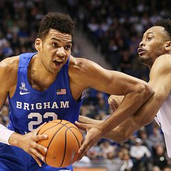 Brigham Young Cougars forward Yoeli Childs (23) spins around Gonzaga Bulldogs forward Johnathan Williams (3) as BYU and Gonzaga play in an NCAA basketball game in the Marriott Center in Provo on Saturday, Feb. 24, 2018.