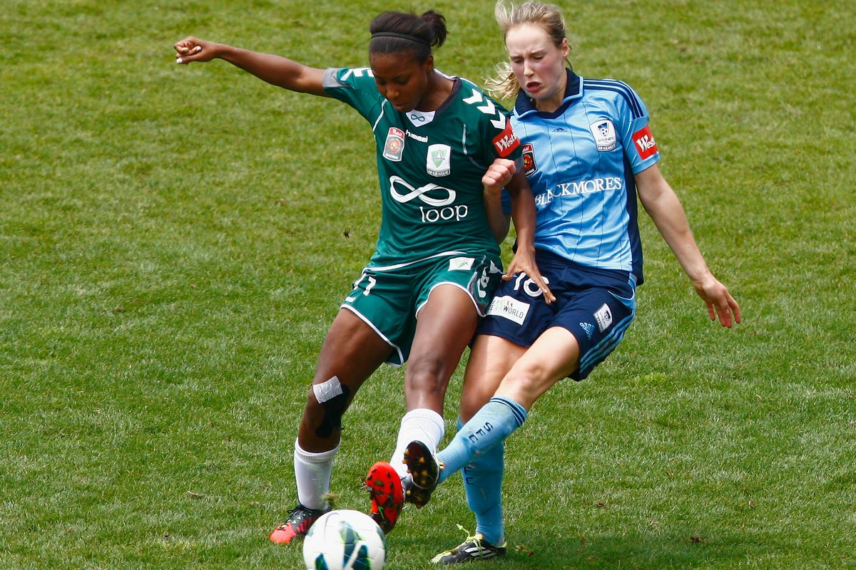 Nikki Washington (in green) scored three goals in five appearances for Canberra United.