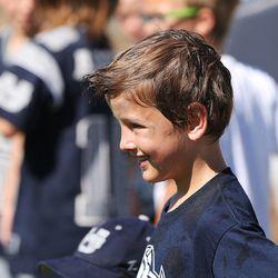 Wyatt Wells, son of Utah State University football coach Matt Wells, participates during a kids football camp in Logan Friday, June 12, 2015.