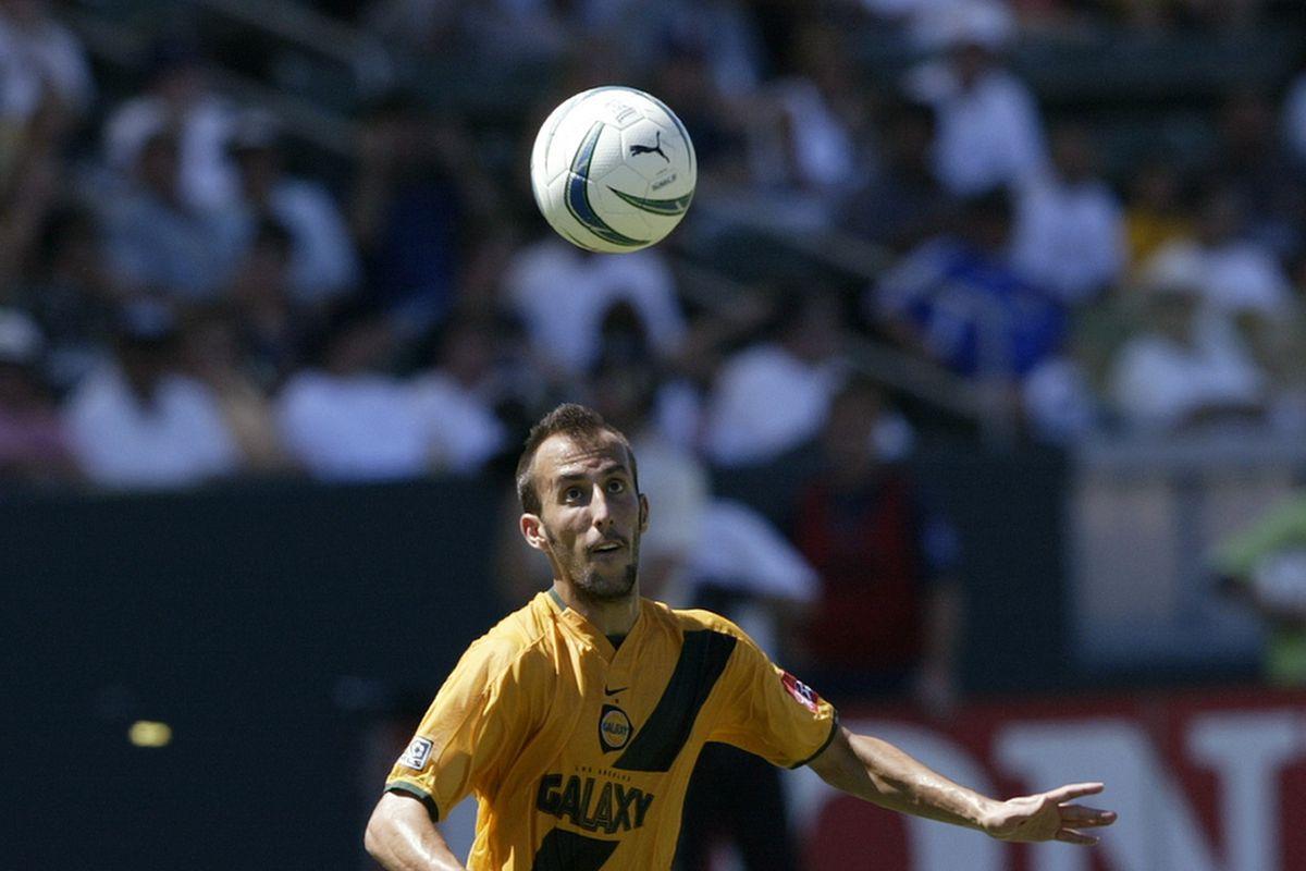 Peter Vagenas heads the ball