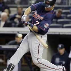 Minnesota Twins' Joe Mauer (7) follows througn on an RBI-double during the first inning against the New York Yankees at Yankee Stadium in New York, Wednesday, April 18, 2012.